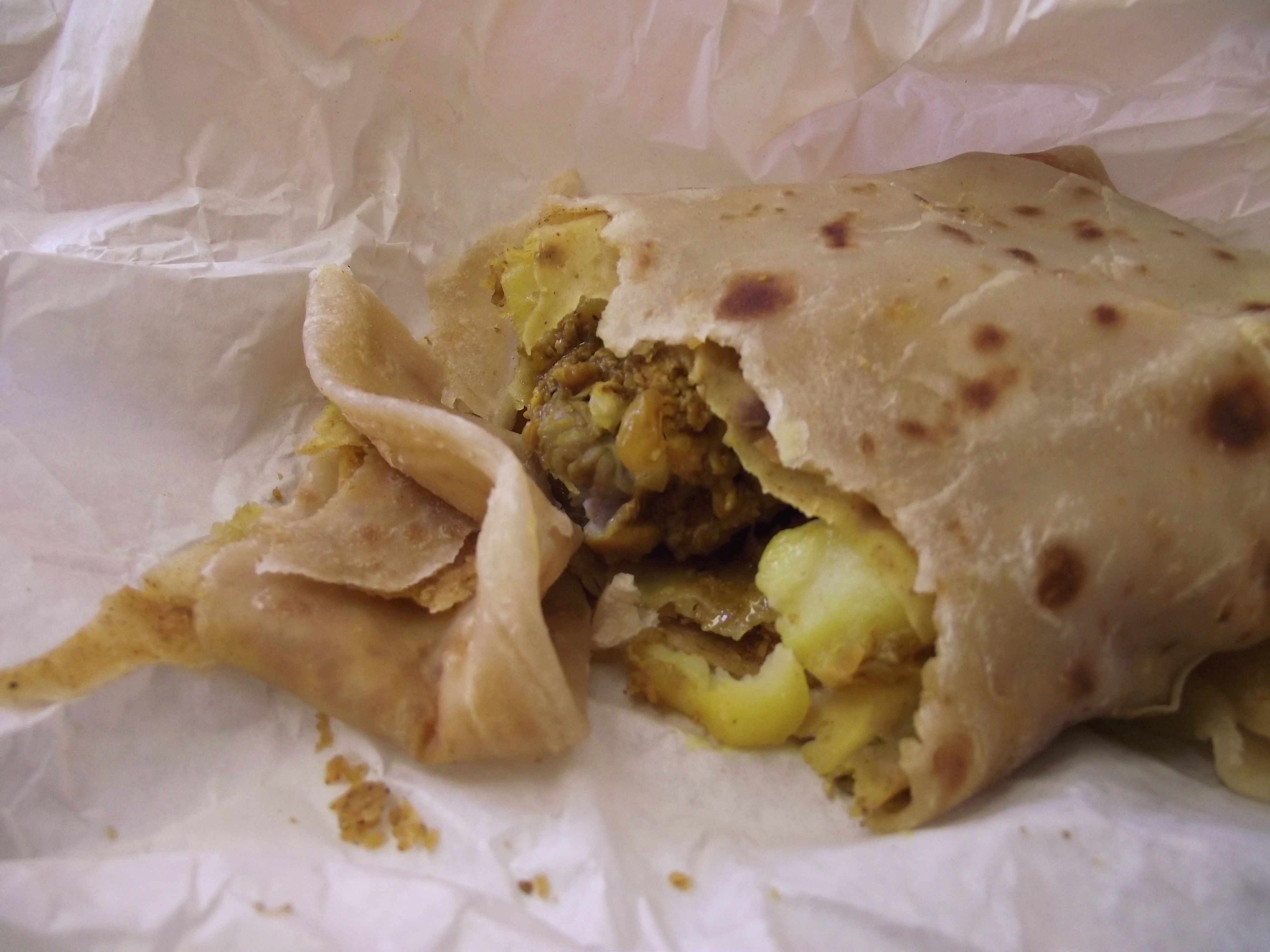 Chicken roti in Grenada, West Indies. Roti is a chickpea