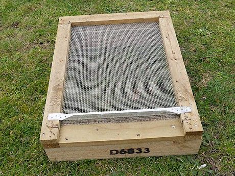 Mesh bottom board for hive.