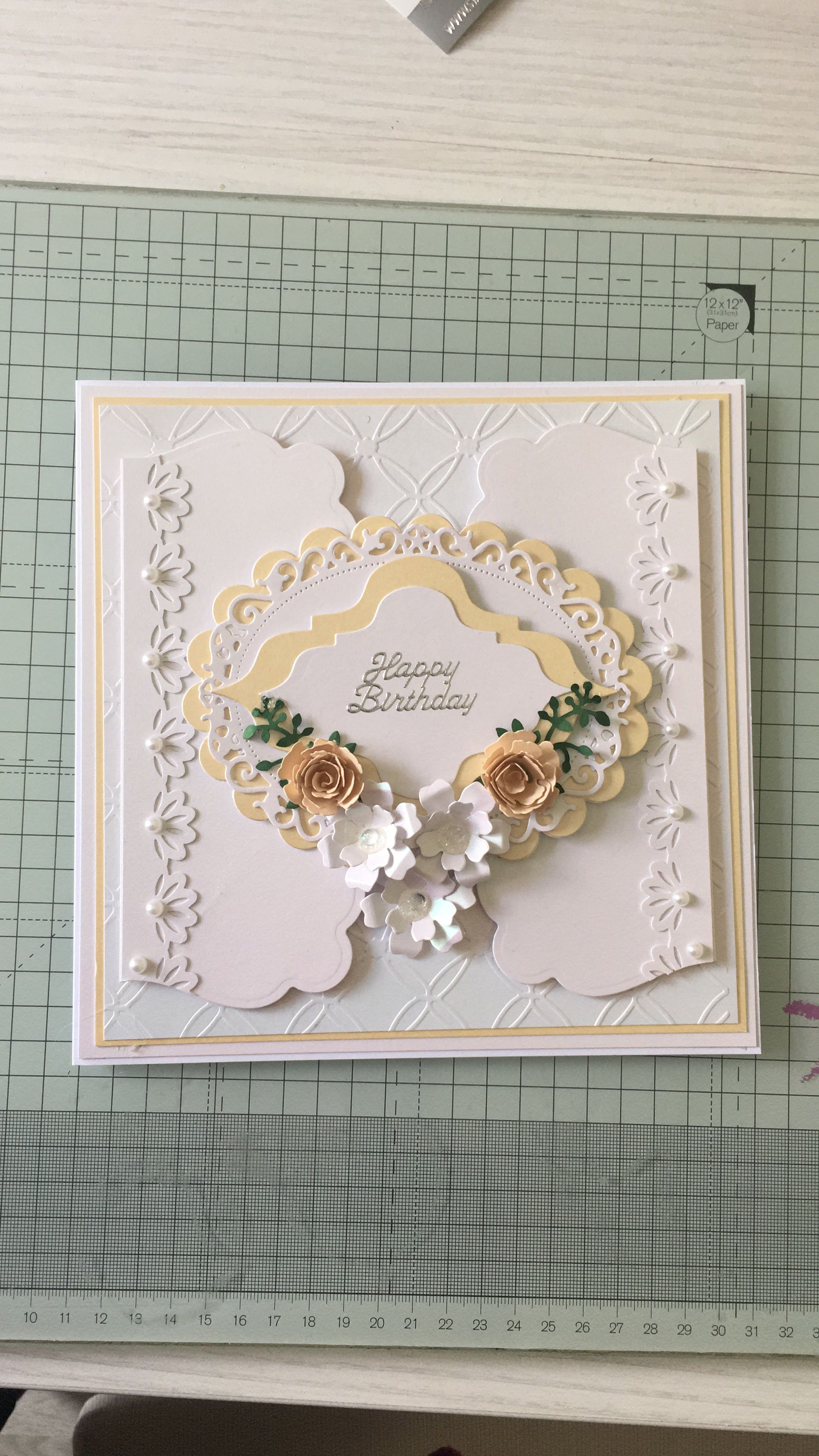 Pearlised floral handcrafted card using several dies