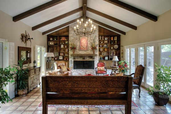 The family room has vaulted ceilings, a stone fireplace ...