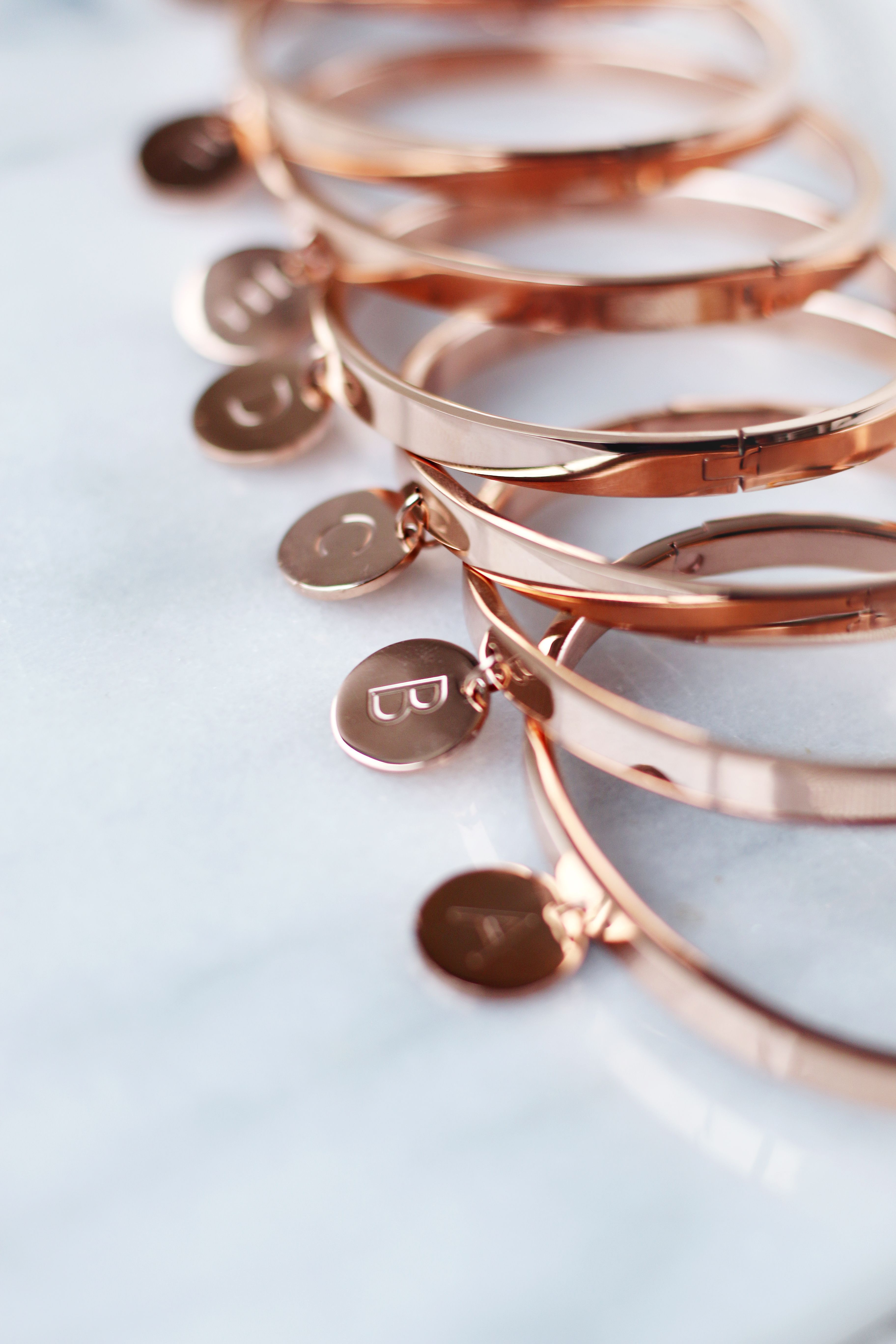 Intitial bangles bracelets in rosé gold u marble available via