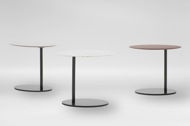 These fun easy and versitile side tables e in Carrera Marble