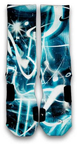 Tron Nike Custom Elite Socks. Pair your favorite kicks with these TRON inspired custom elite socks. Featuring a icy blue galaxy base print with light speed lines. Stars and lightning are added to enhance the futuristic look and feel to the design.