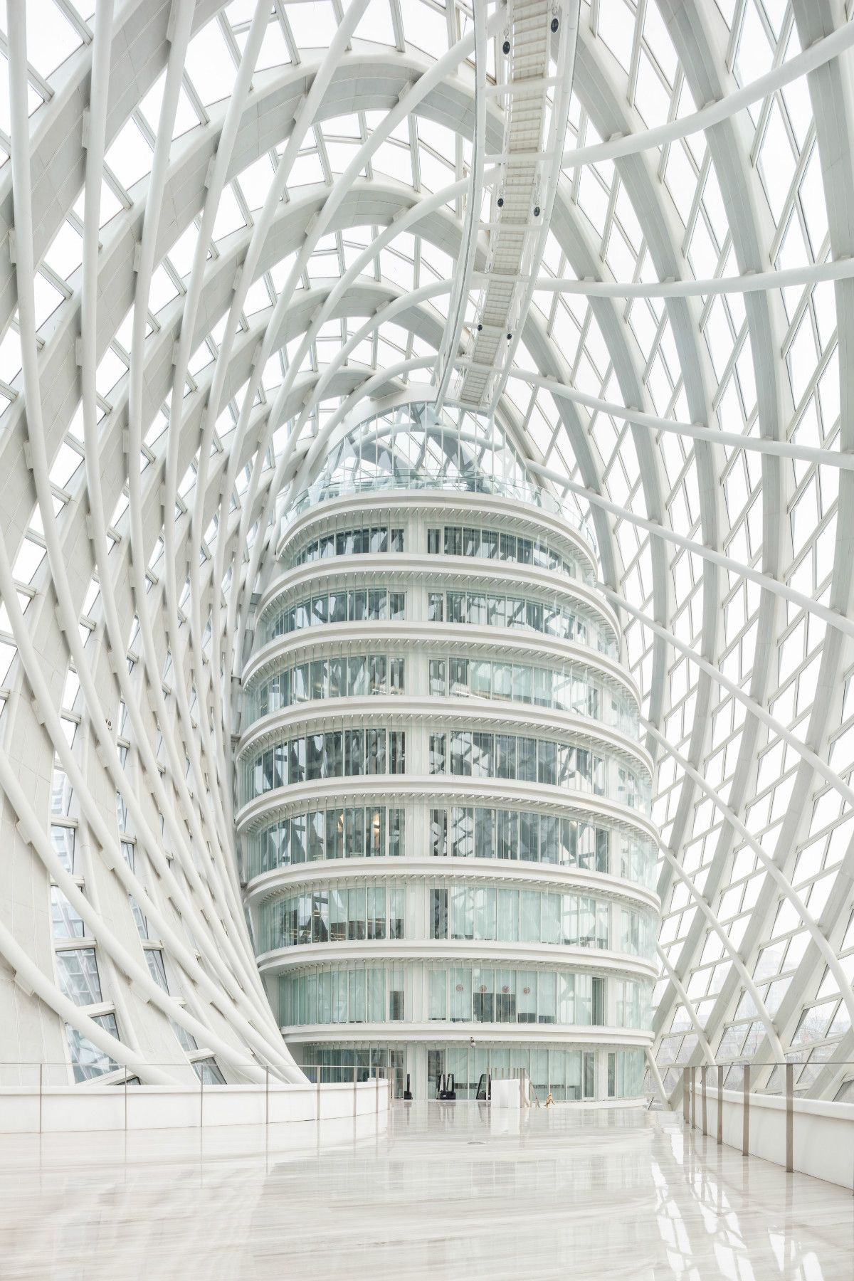 The Beijing TV Studio is Wrapped Up in a Doughnut-shaped Lattice - Arch2O.com