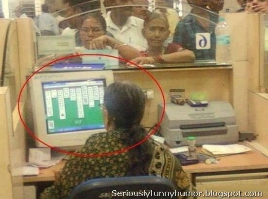 Government clerk plays #solitaire while people wait in line - courtesy clerk