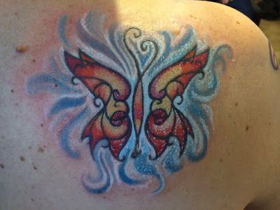 Butterfly tattoo coloured in...