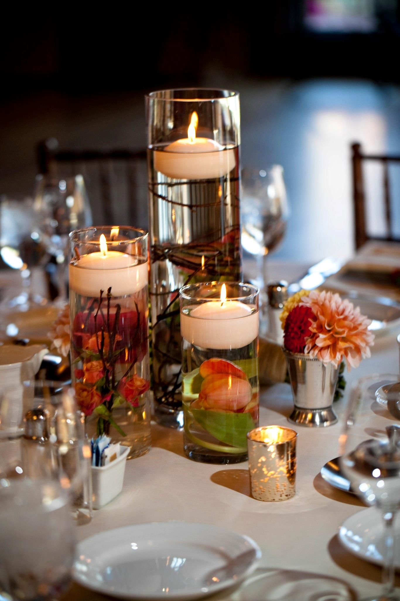 Floating candle wedding centerpiece with submerged flowers - Candle and mirror centerpieces ...