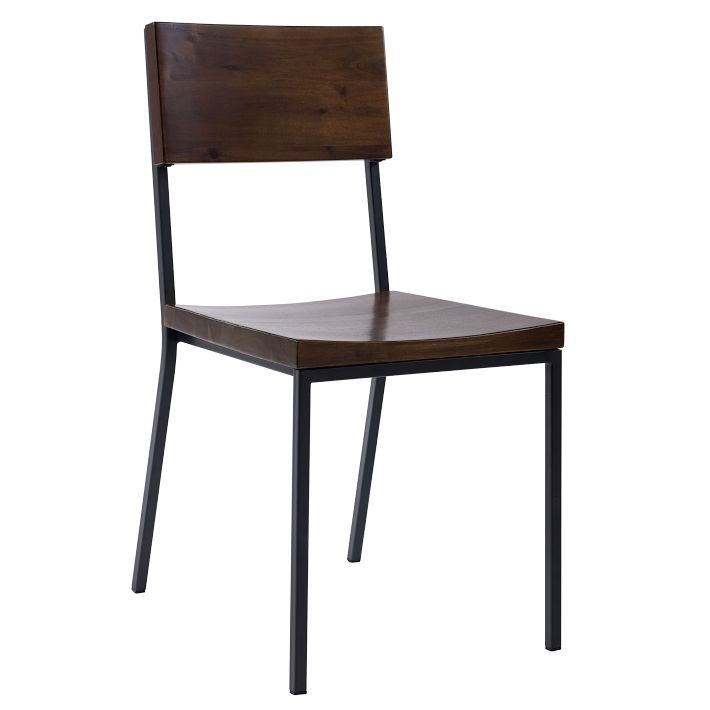 rustic dining chair made of acacia wood and steel, $199 each from West Elm