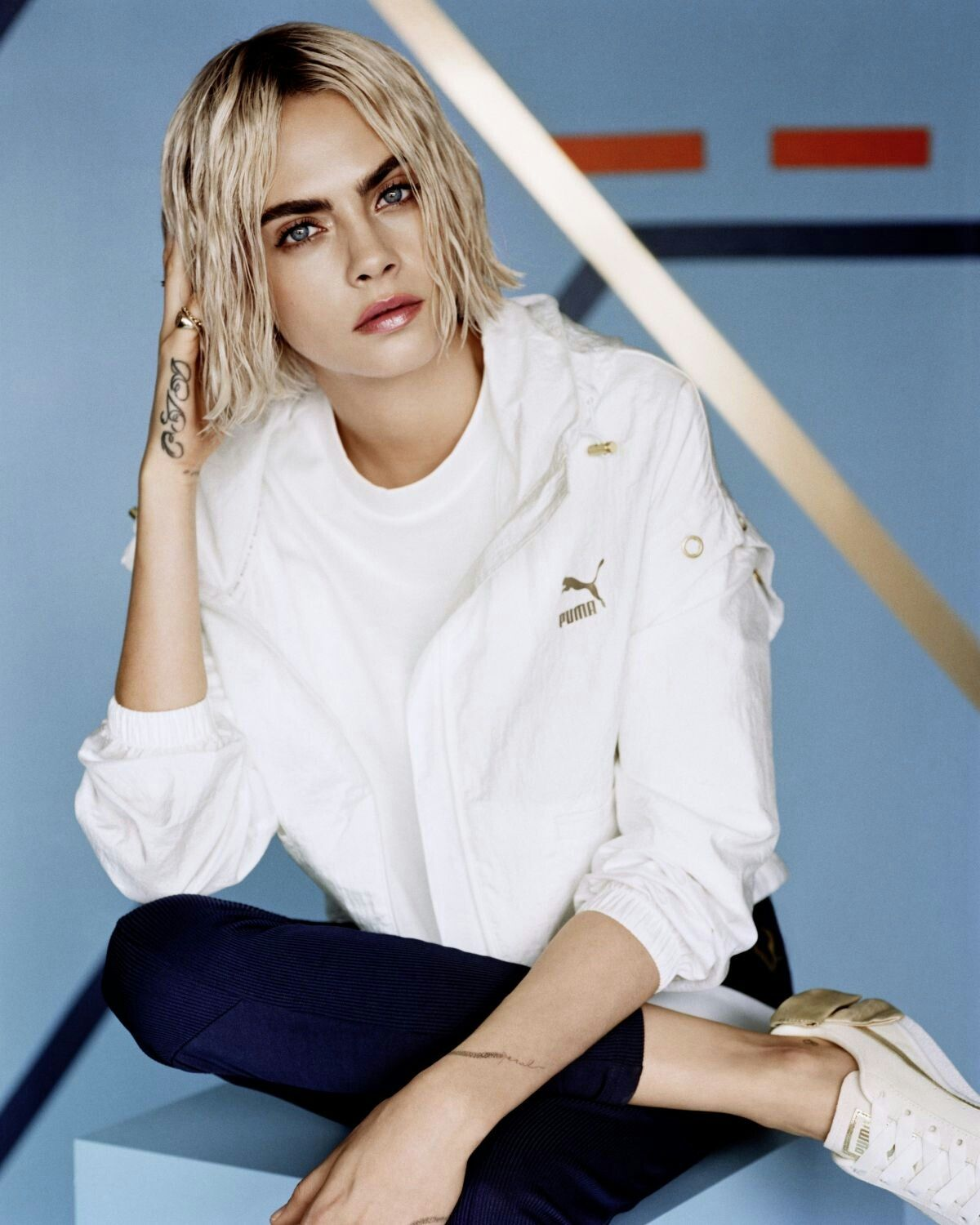Cara Delevingne models the new Puma Suede Bow Varsity