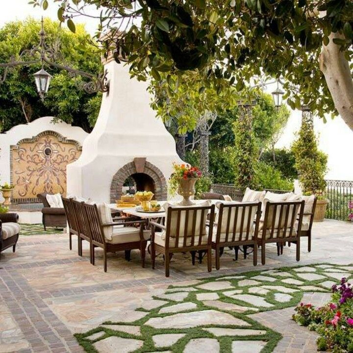 I 39 ve always wanted a huge dining table outside by a for Spanish outdoor fireplace
