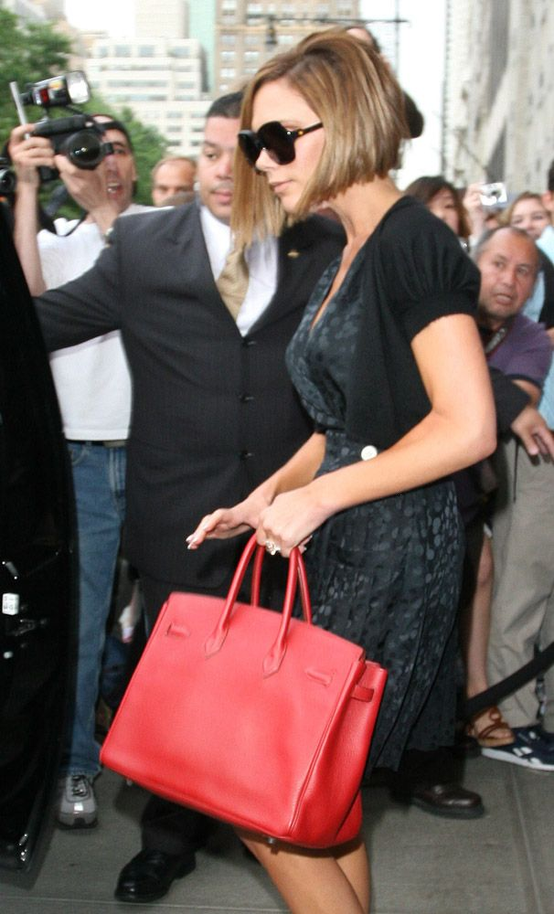 ecda0280b65 Victoria Beckham carrying a red Hermes Birkin