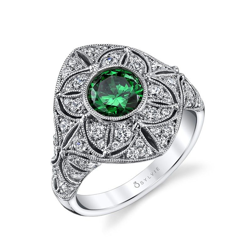 Style# S1264-EM Vintage Round Emerald Bezel Engagement Ring - This vintage inspired engagement ring features a stunning 1.20 round emerald center in a bezel setting accented with milgrain details. https://www.sylviecollection.com/vintage-round-emerald-bezel-engagement-ring-s1264-em