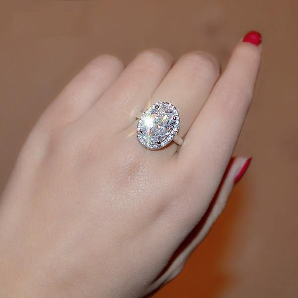 Celebrity 6 Carat Oval Engagement Ring In White Gold Plated Halo
