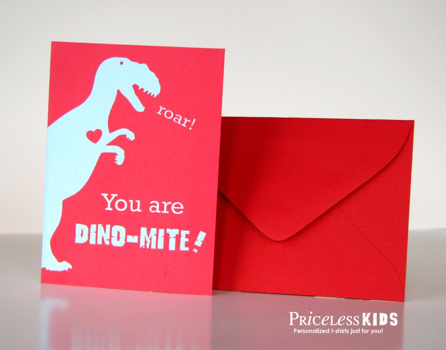 Personalized dinosaur valentine cards for kids. Set of 24 cards with envelopes T-rex in love. $20.00, via Etsy.