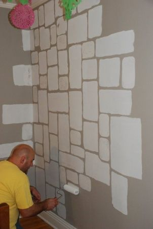A castel stone wall painting the stones onto the wall Grey sponge painted walls