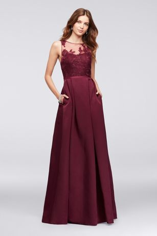 An elegant illusion bodice is topped with floral appliques on this ...