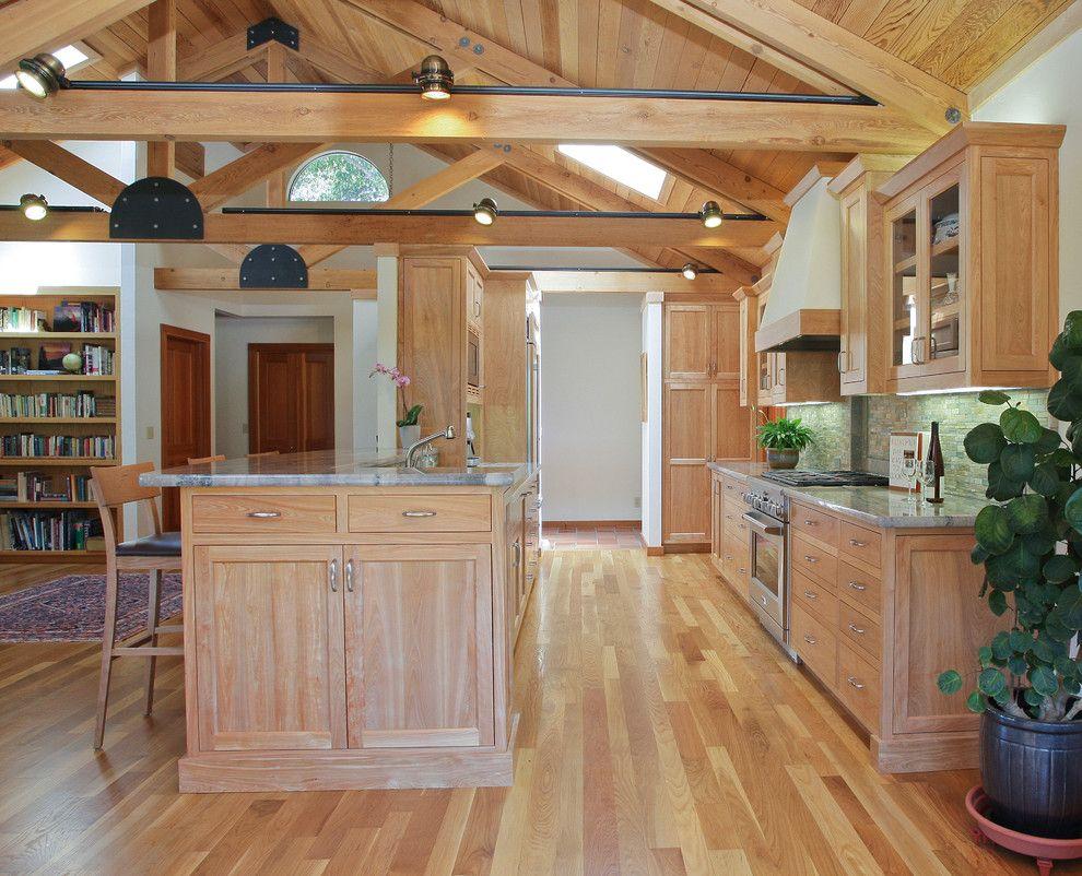 Shelf across kitchen window  light oak kitchen cabinets kitchen traditional with breakfast bar