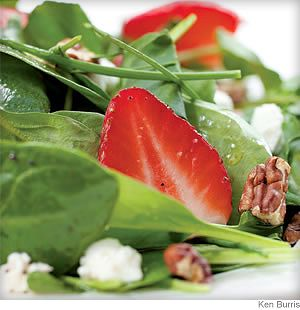 Green Salad With Strawberries and Goat Cheese- This lively salad captures the essence of early summer with ripe strawberries, chives and baby spinach. To make it a meal, top it with grilled chicken breast.