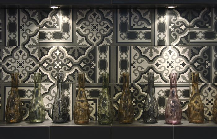 I saw these (Mainzu's 'Florentine') in an Italtile advert in House & Leisure magazine, and like them. The pros are they're available here, whilst the cons are that we may see them in someone else's house.