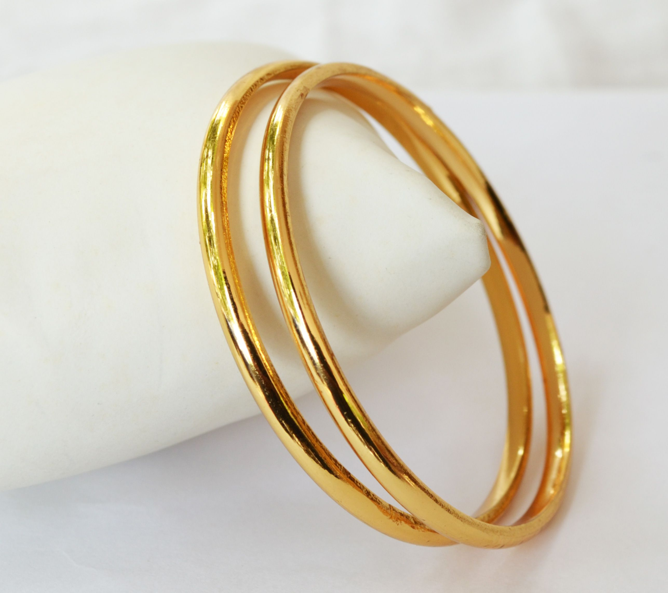 Set of two beautiful plain gold plated bangles. Avoid direct ...