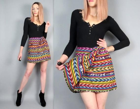 """Vintage 90s Southwest Wrap Mini Skirt* There is some color run throughout the fabric of the skirt, please see all photos *Price reflects these flawsBrand: South of the Border by Catherine Dial EasleyMade in USAMeasurements (laying flat)Waist: 26""""Hips: 36.25""""Length: 17.5"""