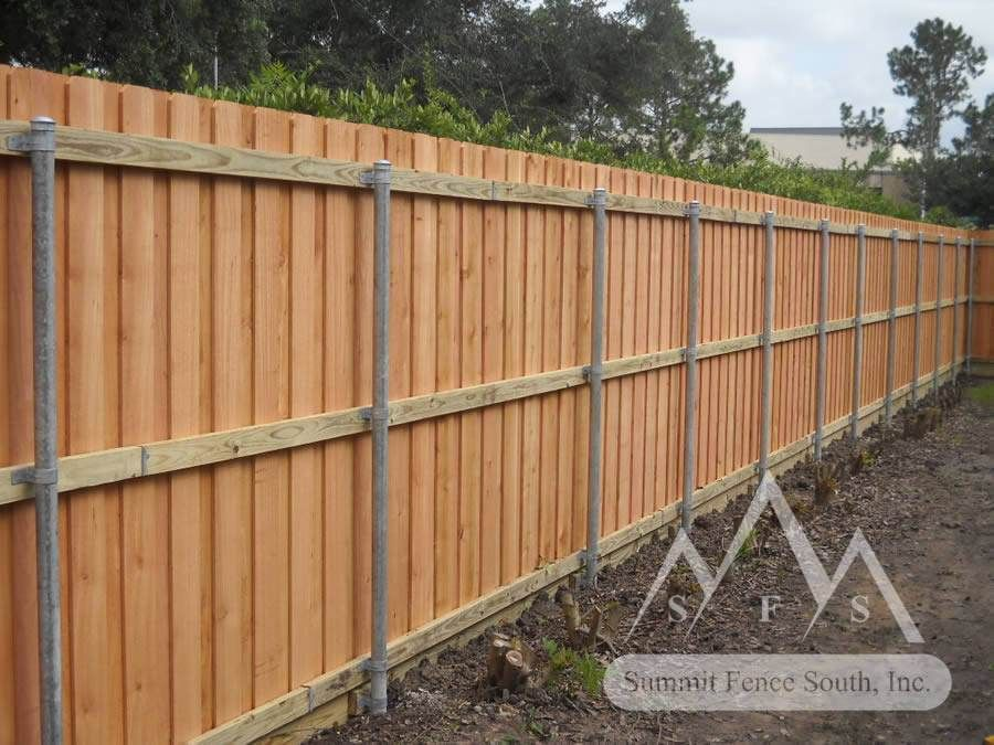 Metal Fence Modern Wooden Fence With Custom Wood Fence With Steel With Images Cedar Fence Cedar Fence Posts Wooden Fence Posts