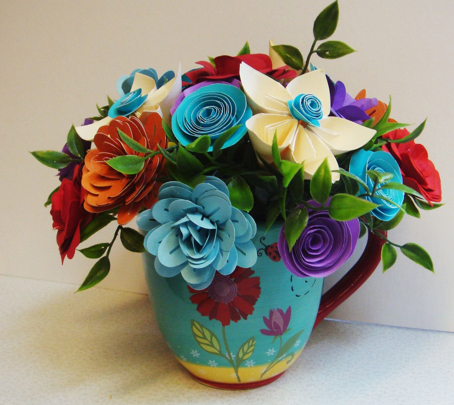 Origami Bright Paper Flower Arrangement In A Lady Bug Coffee Cup