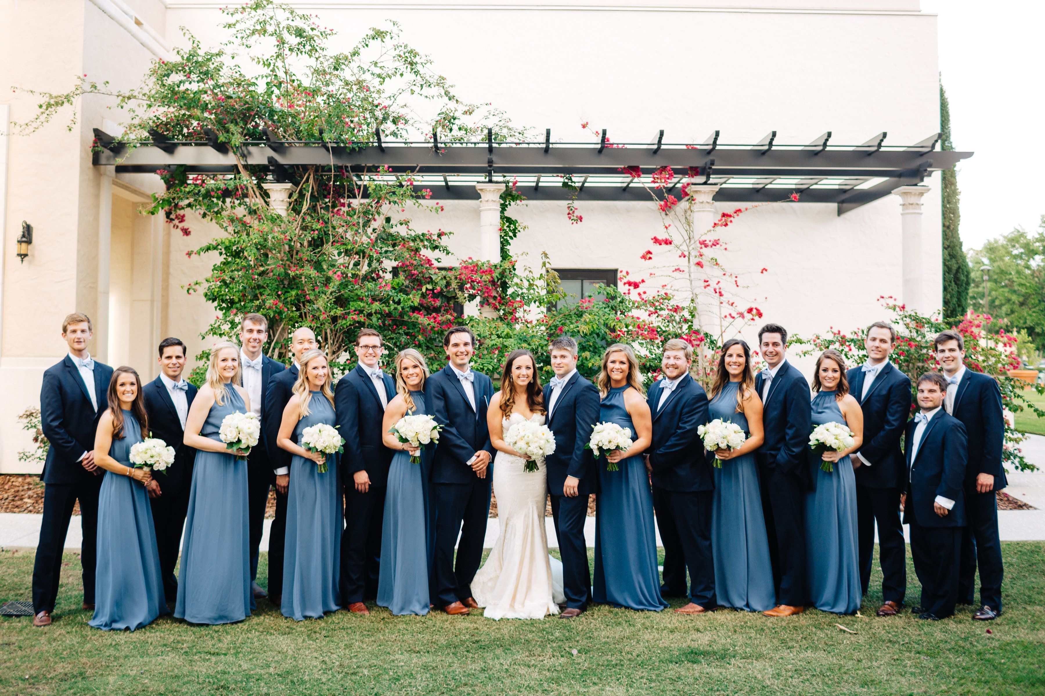 Gromsmen In Navy Suits And Bridesmaids In Blue Gowns The Bridesmaids An Steel Blue Bridesmaid Dresses Slate Blue Bridesmaid Dresses Wedding Bridesmaid Dresses