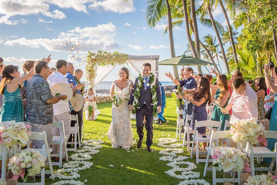 Bride And Groom Exit Their Ceremony At Lanikuhonua At Disney Aulani Aulani Wedding Disney Wedding Hawaiian Wedding