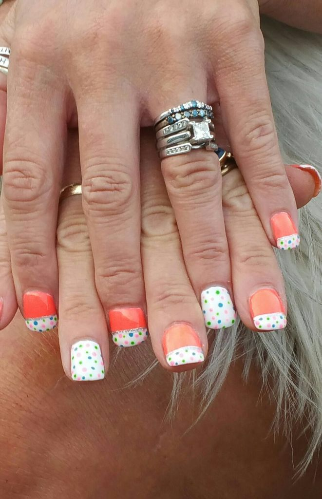 Bright neon coral gel polish nails with white French tip and multi ...