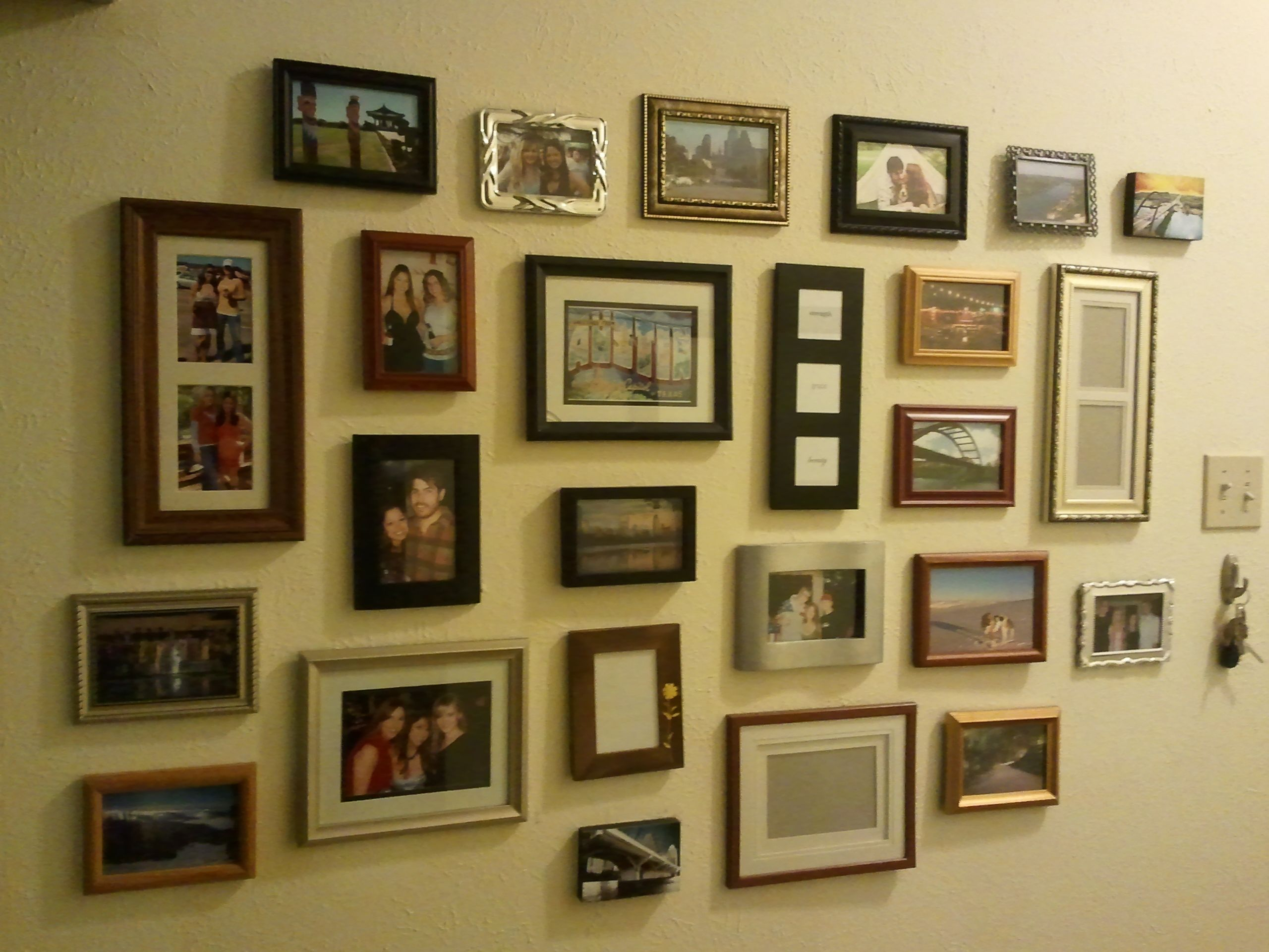 my miscellaneous photo frame wall... I have considered painting all of the frames the same color or shades of the same color, but for now am leaving them just like this