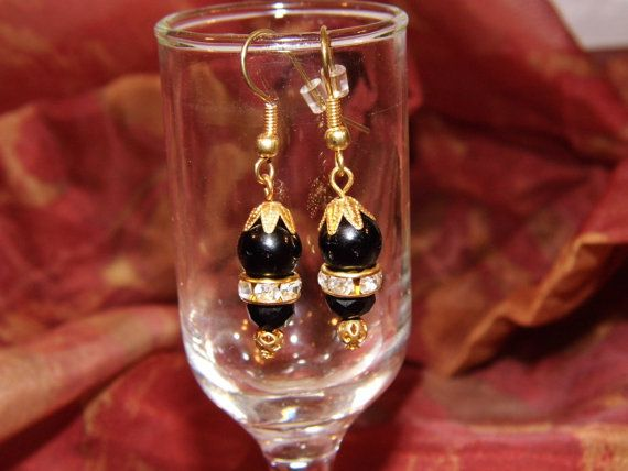 Black Swarovski crystal and glass Onyx beaded Dangles with a crystal gold tone spacer .. Nice formal look ..