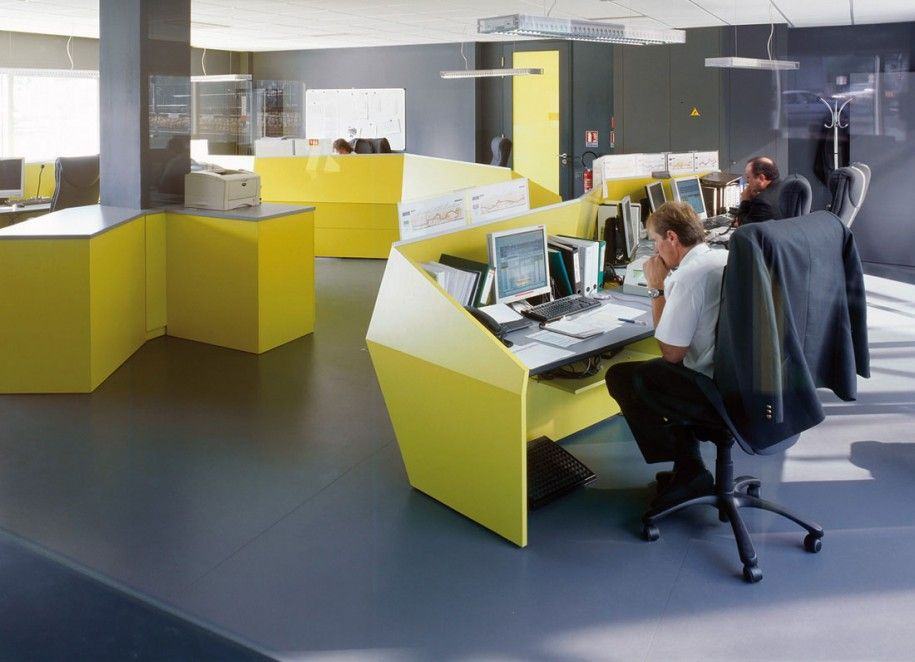 Office interior designs with color block theme : yellow desk grey