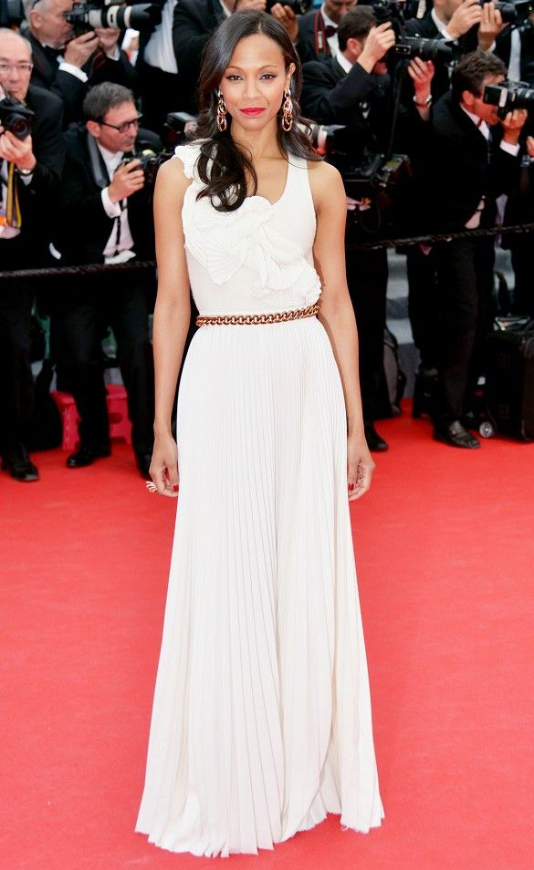 4ca619f6ebd Zoe Beckham wears a Victoria Beckham white pleated dress with statement  earrings.