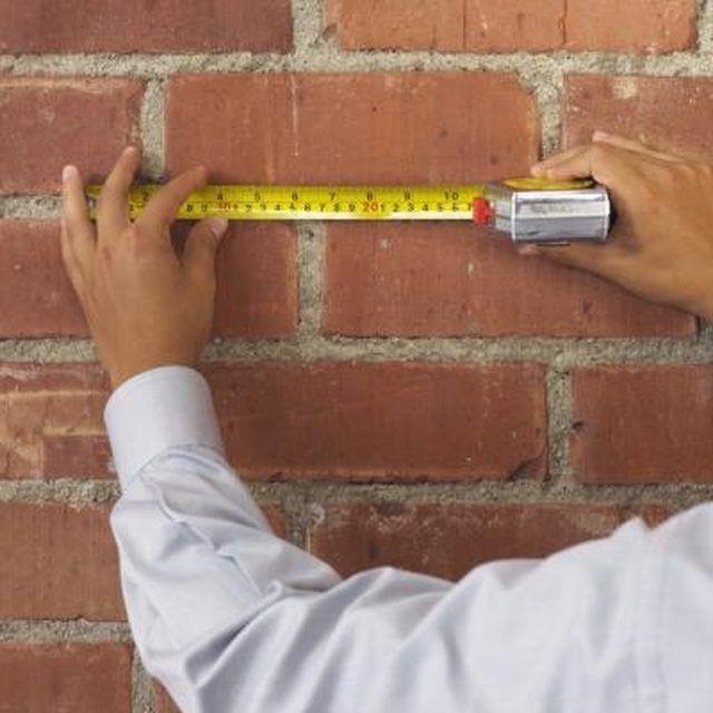 How To Hang A Shelf On Drywall Homesteady Concrete Wall Masonry Wall Building Shelves