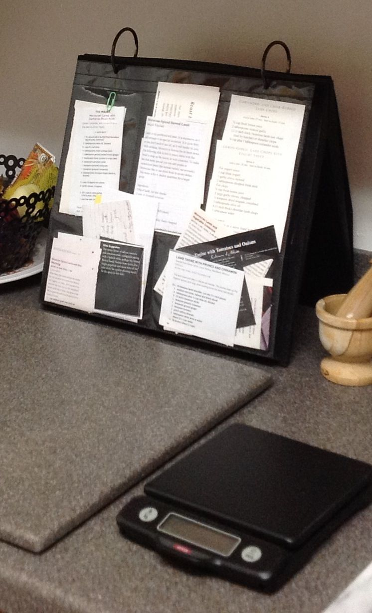 use a photo album to keep recipes for easy & clean access in the kitchen