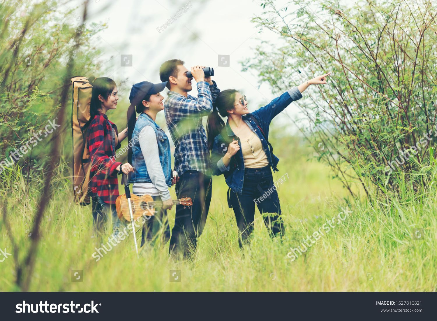 Group asian traveler with backpack adventure holding map ...