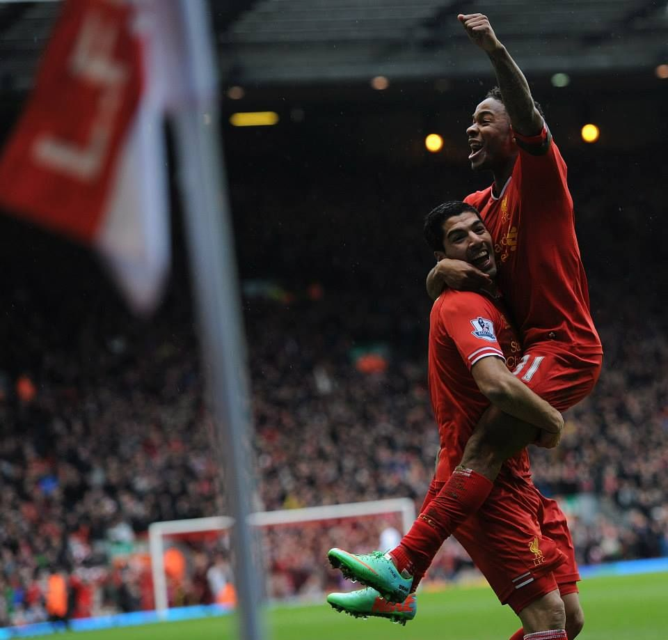 Sterling celebrates with Suarez after he set him up with a fantastic through pass. #LFC