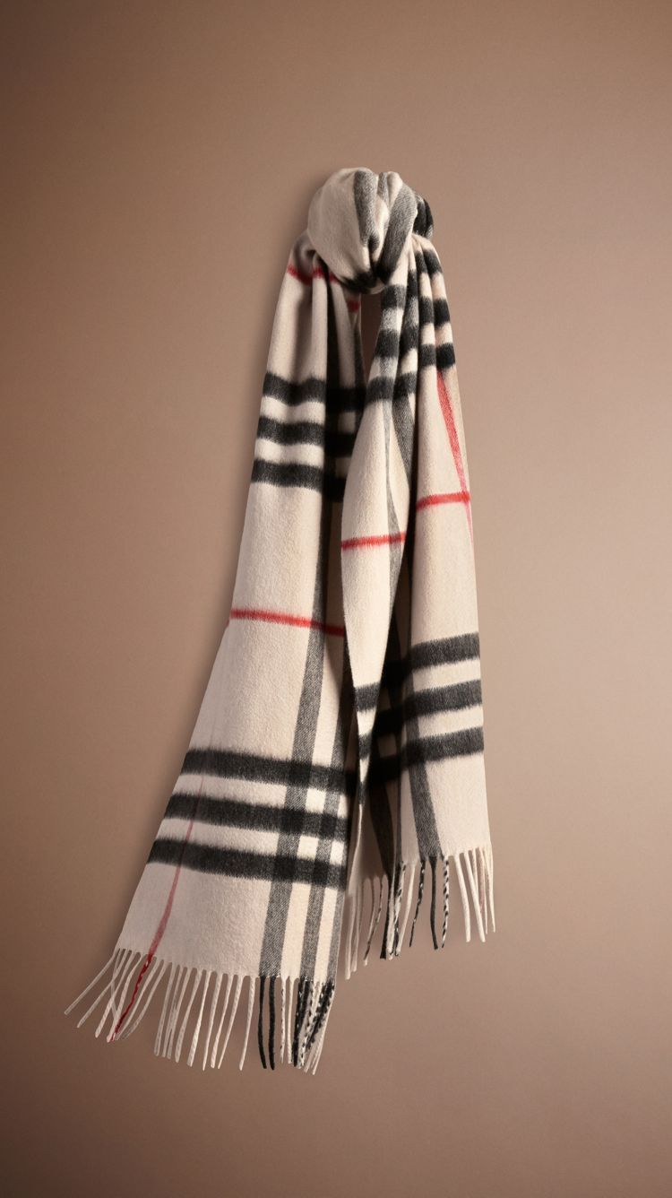 A soft brushed cashmere scarf featuring the iconic check. The scarf is made  in Scotland at a mill with a long heritage in producing cashmere. 7bdfa47f3bc0