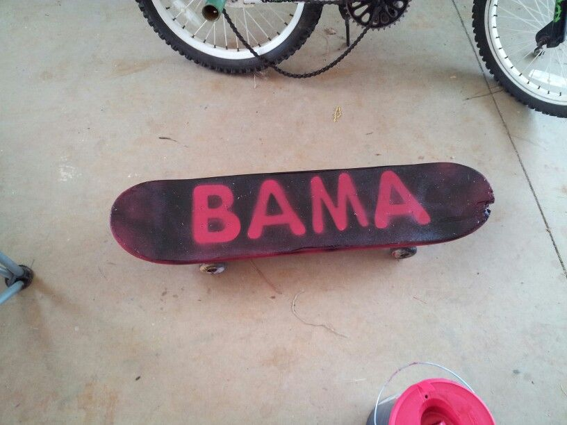 Freshen up my kids old skateboard with left over paint. Painted board red with house paint, laid letters on it and spray painted for another job. Leaving the image on the board. Super cheap and my kids love it