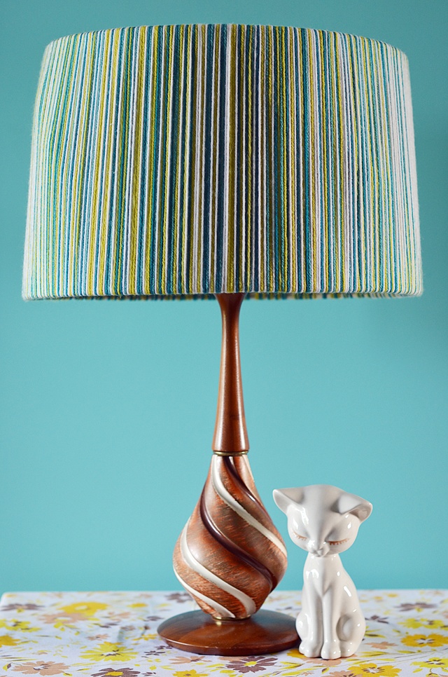 Light up a vintage lamp by stringing yarn around the