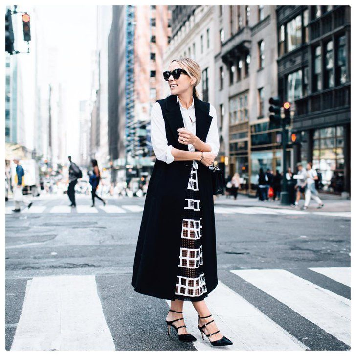 Pin for Later: 38 Outfit Ideas That'll Get You Through Thanksgiving Dinner in Style A Collared Shirt, Waistcoat, and a Full Skirt