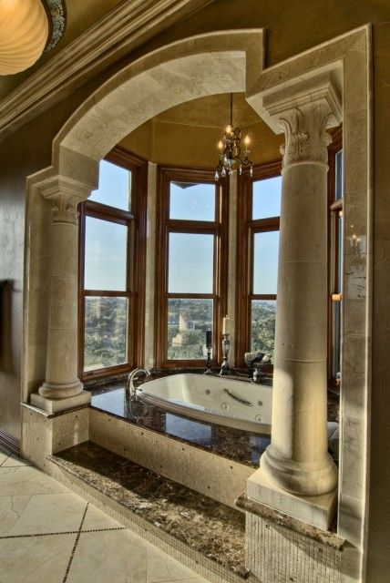 Elegant Master Bath Whirlpool Soaking Tub Framed By Columns