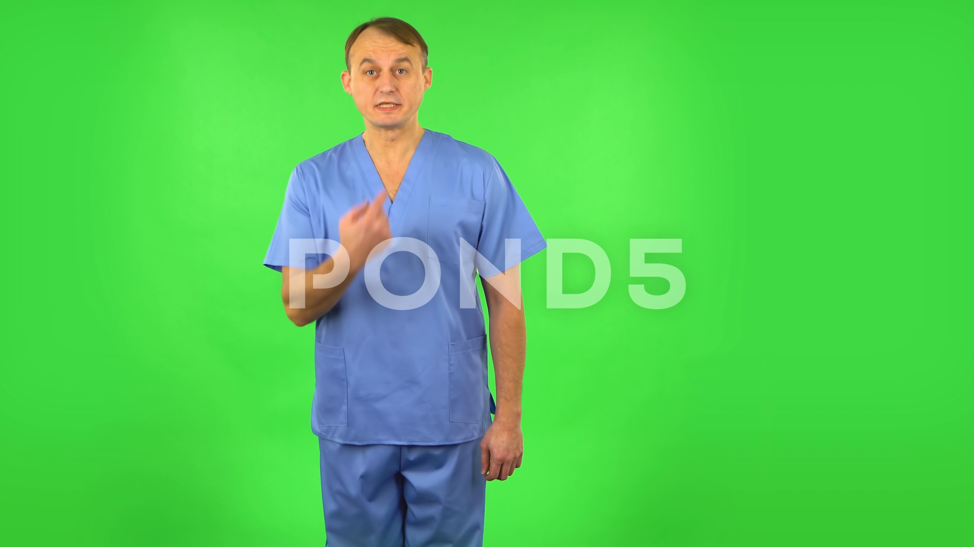 Medical man throwing up hands expressing he is innocent, twists his finger at #AD ,#hands#expressing#throwing#Medical
