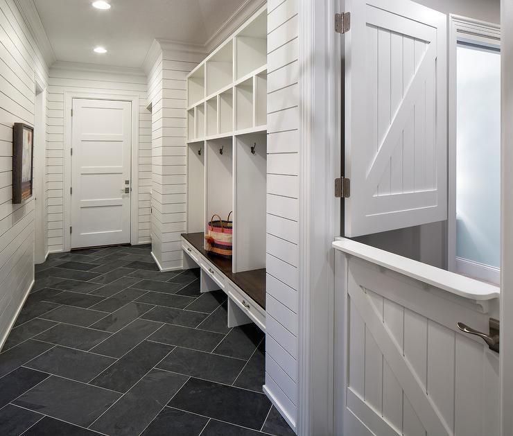 A white shiplap dutch door opens to