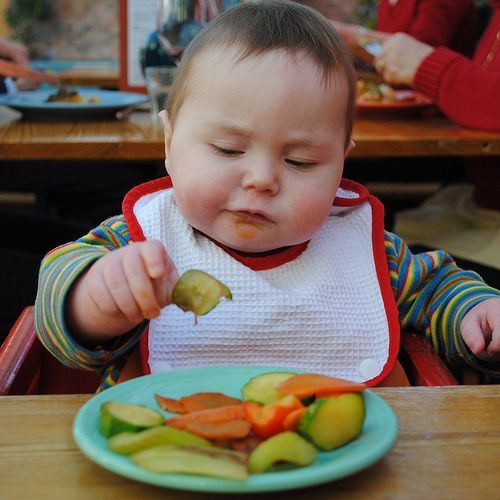 """""""Baby Led Weaning"""" is skipping thin, runny purées & not using a spoon. BLW means offering baby (age appropriate) soft-cooked foods, cut or mashed into easily manageable pieces. Foods are given to baby without being pureed. You cook, dice, mash, & offer food, & baby does the rest! Baby is in control, you never actually feed him by putting the foods in his mouth. As with breastfeeding on demand, BLW is a method of introducing foods that leaves it up to baby to decide what, when & how much to…"""