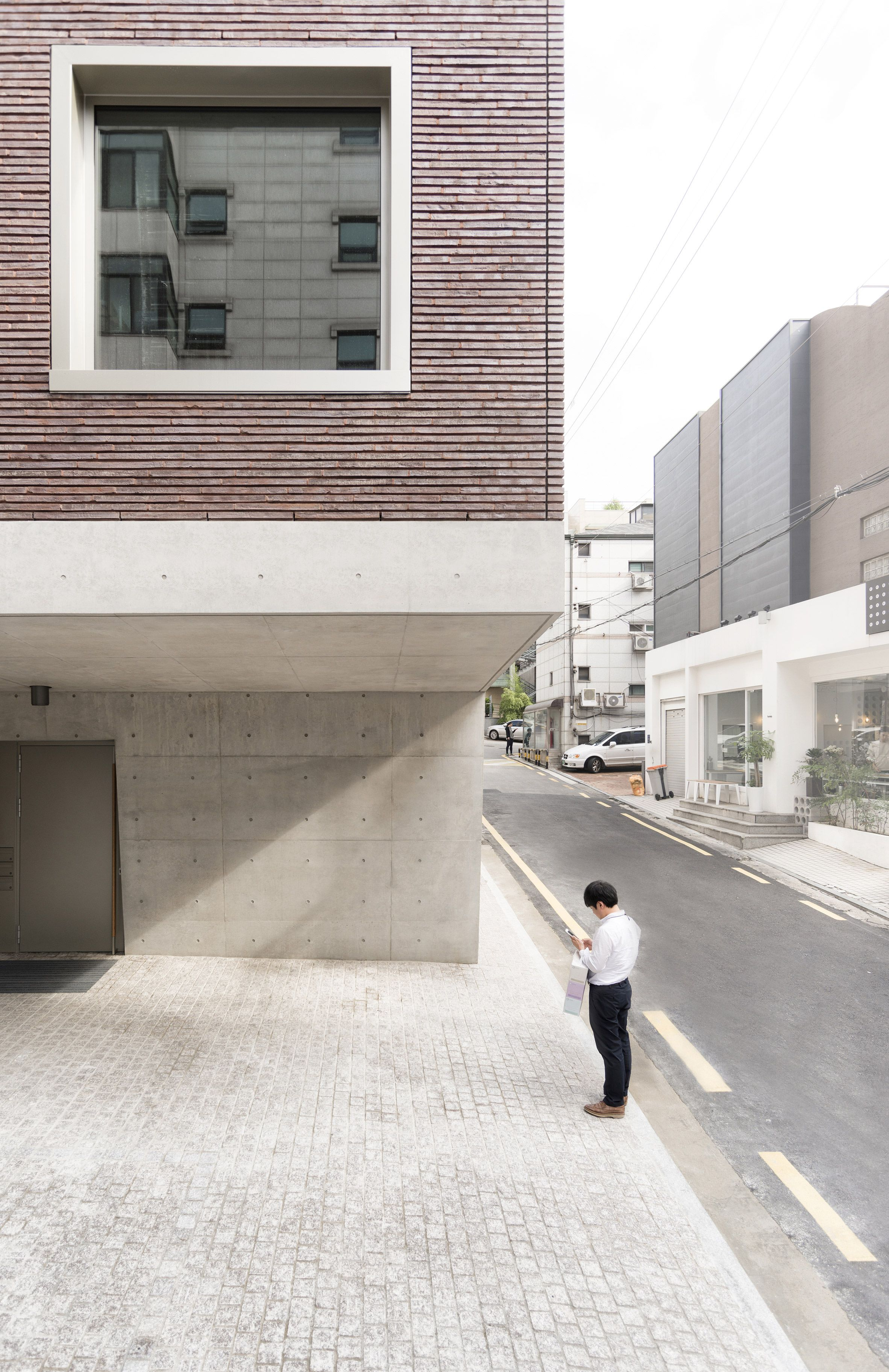 top heavy office and apartment block features brick top and concrete base - Concrete Apartment 2016