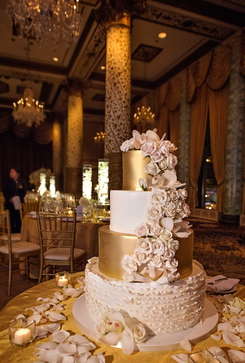 white gold and blush four tier wedding cake with cascading ...