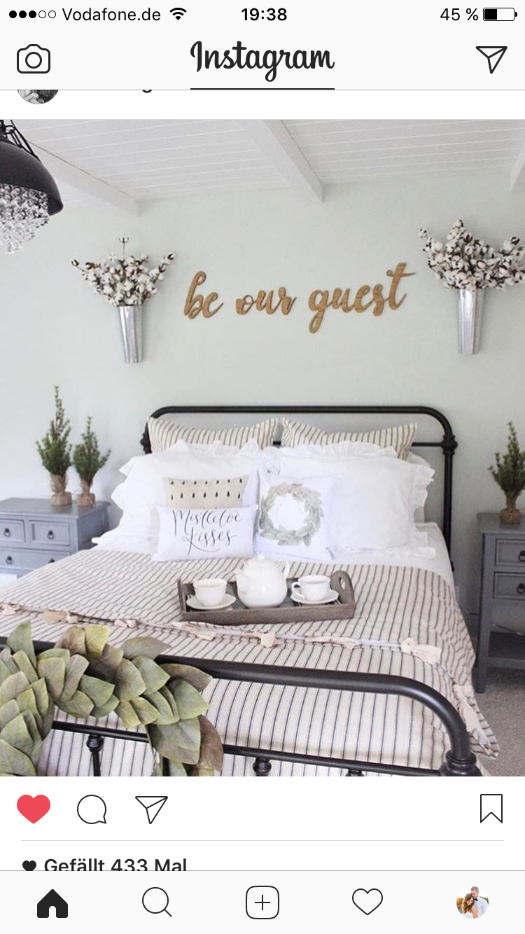 Farmhouse Guest Bedroom With Rod Iron Bed From Bedding From Black Crystal  Chandelier From And Be Our Guest Wood Signs.