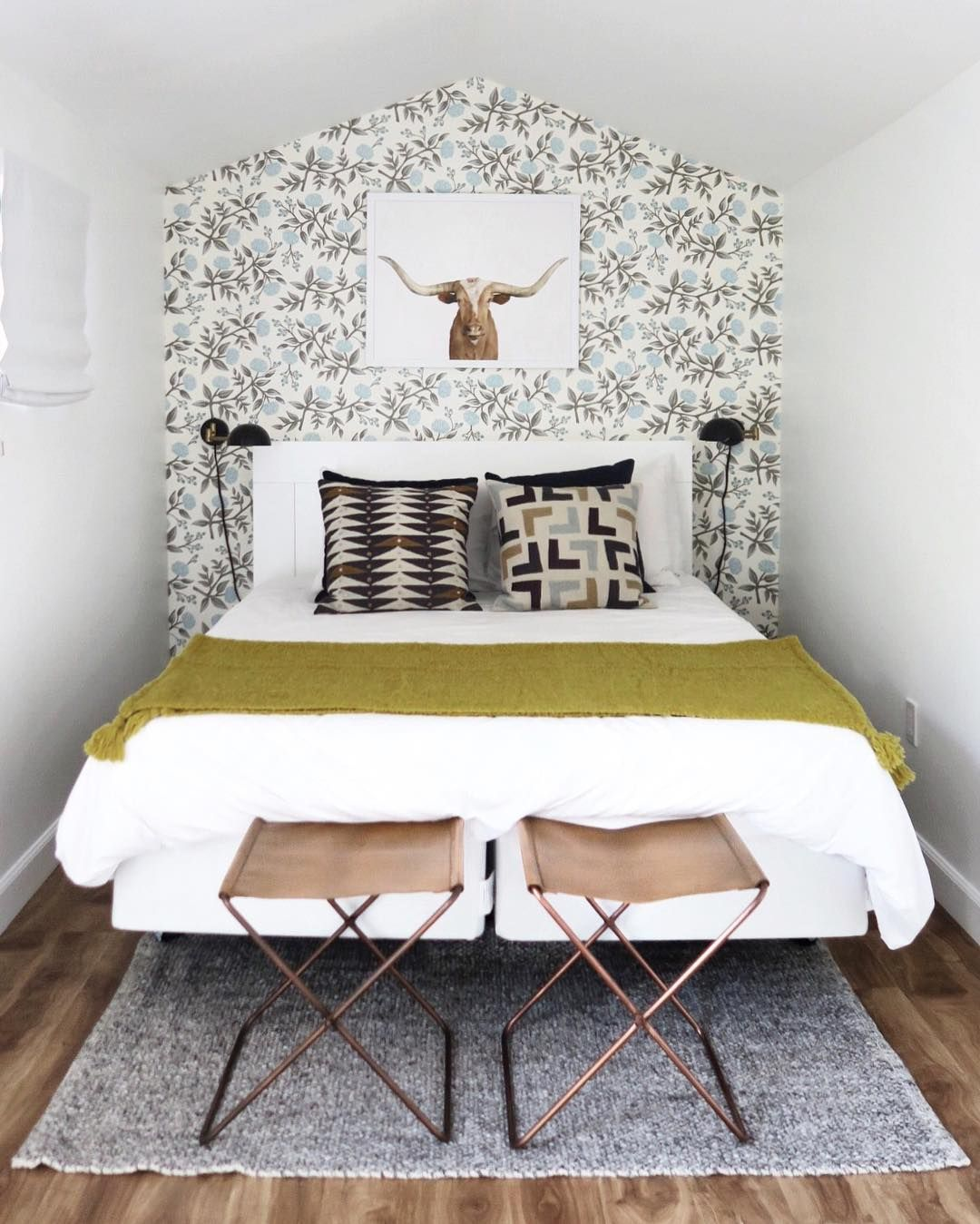 Two Small Stools Paired With A Small Rug And Wallpaper Small Apartment Bedrooms Small Guest Bedroom Small Bedroom Decor